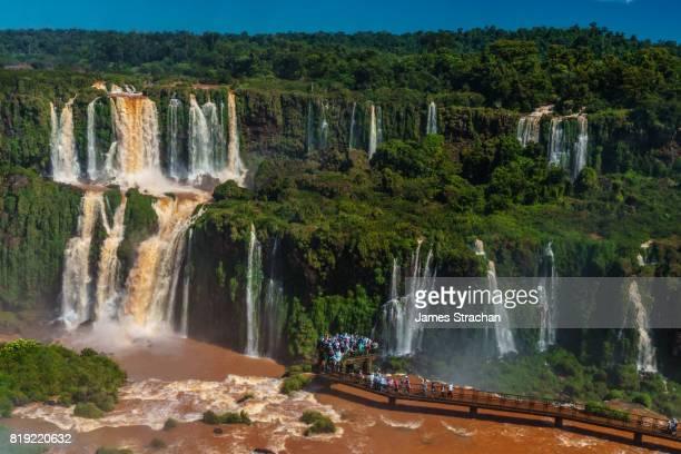 View over the Garganta del Diablo (Devil's Throat), Iguazu Falls (UNESCO World Heritage Site) from Brazilian side, with visitors on walkway in foreground, Iguazu, Brazil