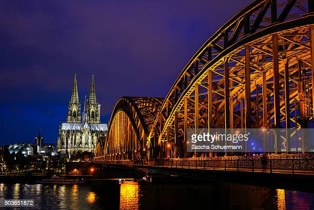 View over the Rhine to the of Cologne with Cologne Cathedral Hohenzollernbrücke Hauptbahnhof main railway station philharmonic concert hall and...