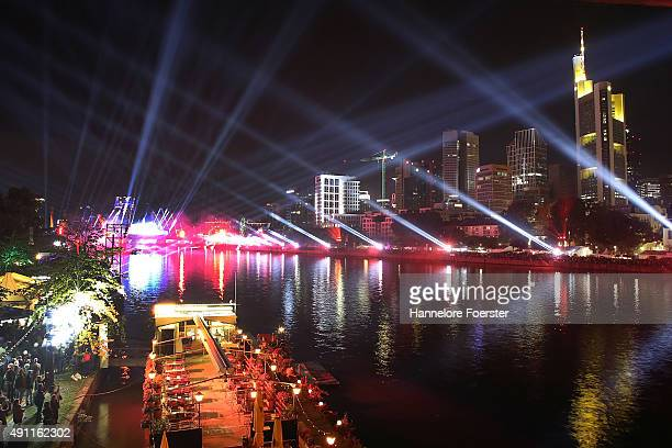 A view over the river Main and the skyline where a light show is taking place for the 25th anniversary of German reunification on October 3 2015 in...