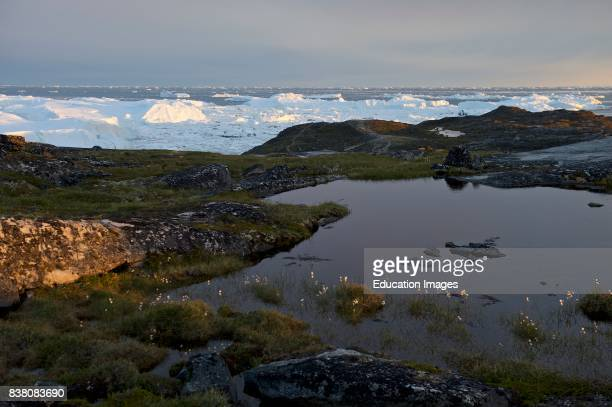 View over the UNESCO world heritage site the Ilulissat ice fjord is located on the west coast of Greenland 250 km north of the Arctic Circle The...