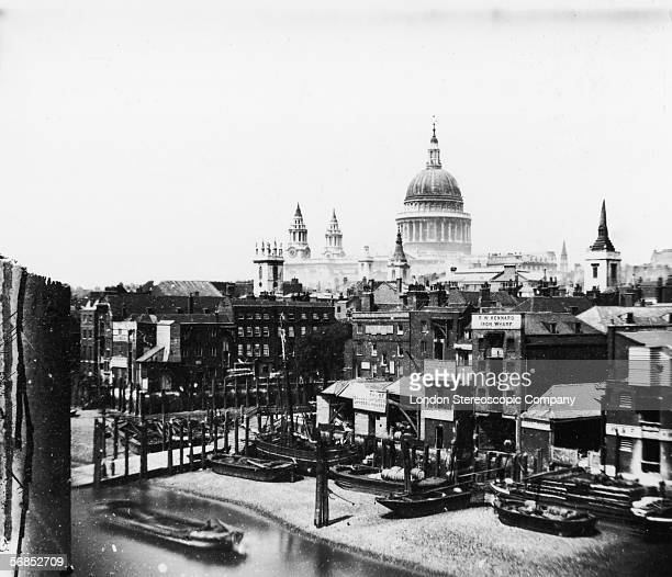 A view over the warehouses on the north bank of the Thames to St Paul's Cathedral circa 1870