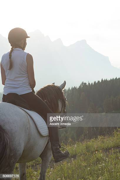View past woman on horseback to distant mountains