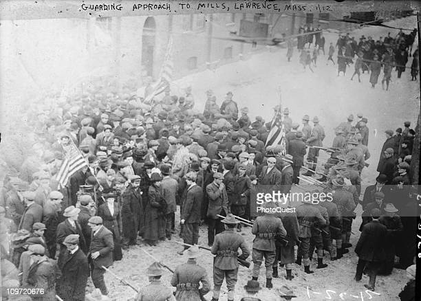 View showing Massachussetts militiamen with fixed bayonets guarding the approach to the mills in Lawrence MA 1912 This scene unfolded during the...