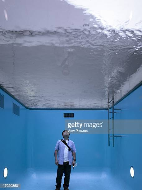 View showing solo figure within Argentinian artist Leandro Erlichs work 21st Century Museum Museum Asia Japan SANAA