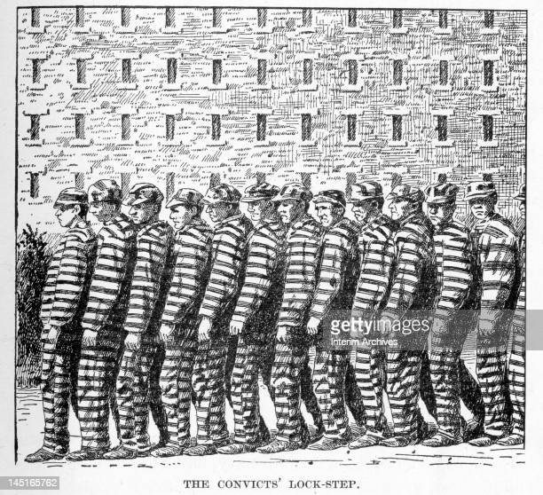 View showing the convicts' lock step or chain gang a method of marching prisoners wearing striped uniforms from one place to another as used in the...