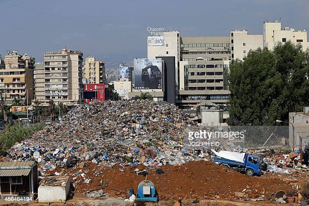 A view shows a temporary garbage dump on the site of the highway of Sadd alBawshriyeh at the northern entrance of the capital Beirut on September 4...