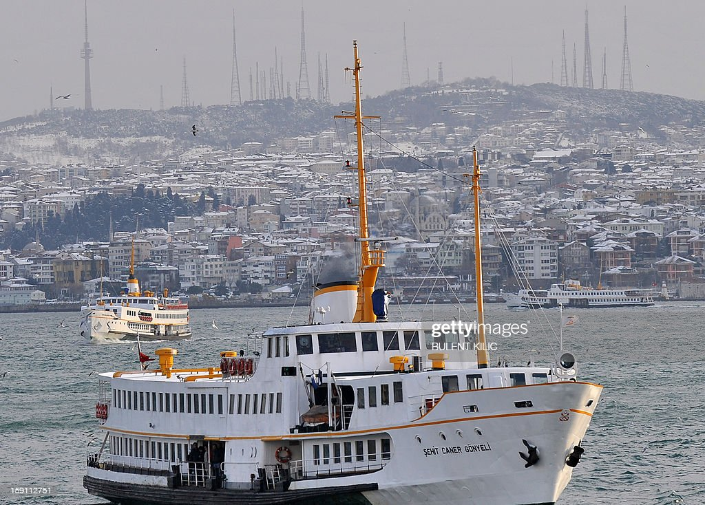 View shows ferries sailing on the Bosphorus in Istanbul on January 8, 2013. Heavy snowfall blanketed Turkey's commercial hub Istanbul, a city of 15 million, paralysing daily life, disrupting air traffic and land transport. Officials said the snow expected to continue until late tomorrow, according to the weather forecast.
