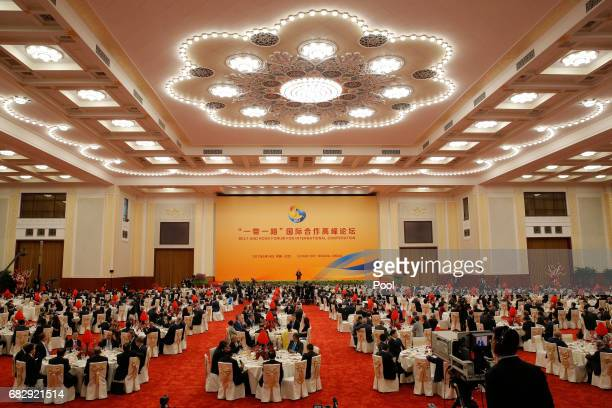 A view shows guests listen while Chinese President Xi Jinping delivers a speech during a welcome banquet for the Belt and Road Forum at the Great...
