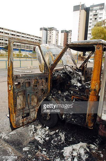 A view taken 02 November 2005 in the northern Paris suburb of AulnaySousBois shows a damaged truck after gangs of youths clashed with police and...