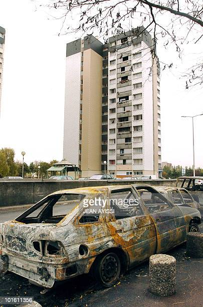 A view taken 02 November 2005 in the northern Paris suburb of AulnaySousBois shows damaged cars after gangs of youths clashed with police and torched...