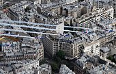 A view taken from a helicopter shows Alphajet aircrafts from the French elite acrobatic flying team Patrouille de France releasing smoke in the...