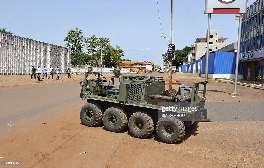 View taken in Bangui on March 26, 2013 of a vehicle abandonned by South African forces following clashes with rebels. South Africa's government today faced calls for an inquiry over the sending of troops to the Central African Republic after 13 soldiers died in weekend clashes with rebels. The main opposition Democratic Alliance said the 'highly questionable deployment' -- which led to South Africa's heaviest military losses since apartheid -- should be probed by parliament.