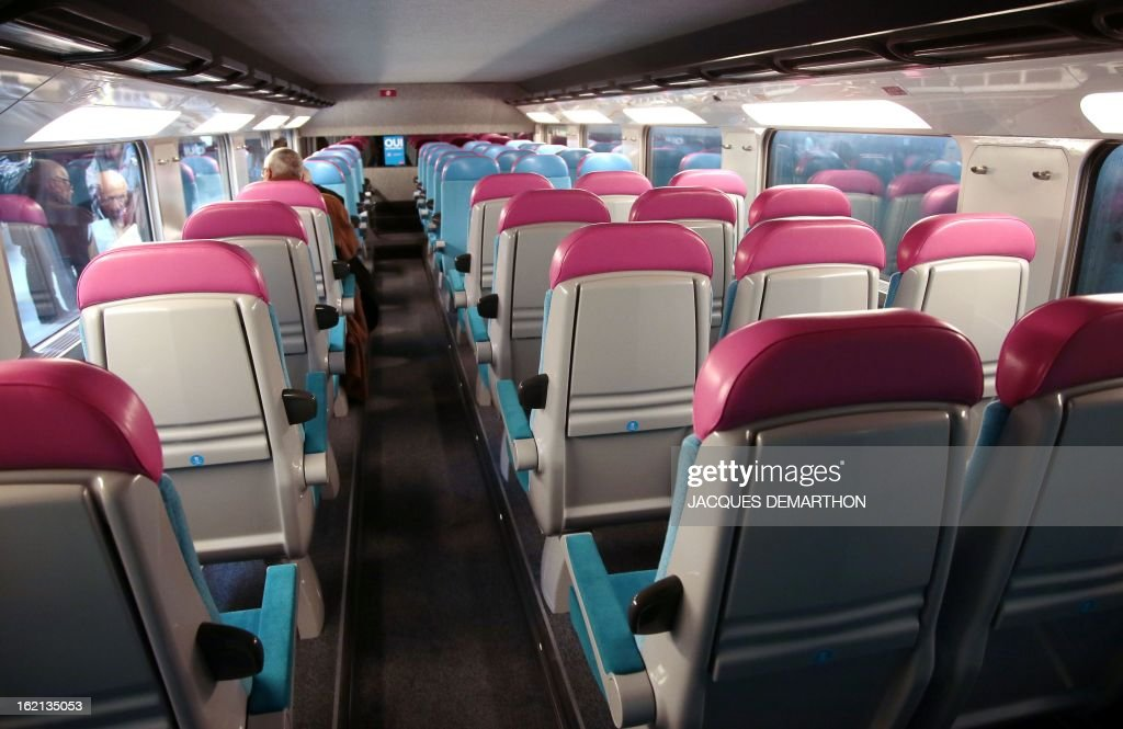 View taken inside of the new low-cost TGV high-speed train 'Ouigo' at the Marne-La-Vallee railway station ouside Paris on February 19, 2013, during its presentation to the press. France's state rail firm SNCF opened its online booking service for its new budget train service 'Ouigo' on February 19 inspired by the budget airline model. The train will start transporting its first passengers from April 2, with the Ouigo service operating from Marne-la-Vallée near Disneyland Paris, Lyon-Saint-Exupéry airport, Marseilles and Montpellier.