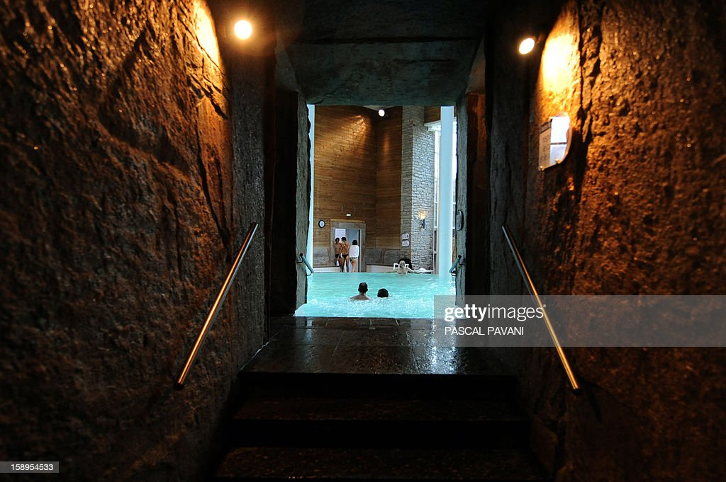 View taken of the corridor leading to an indoor Roman bath where holidaymakers relaxing, on January 3, 2013 at Balnea thermal spa in Loudenvielle, southwestern France. Balnea is the first thermal spa of the French Pyrenees range of mountains.