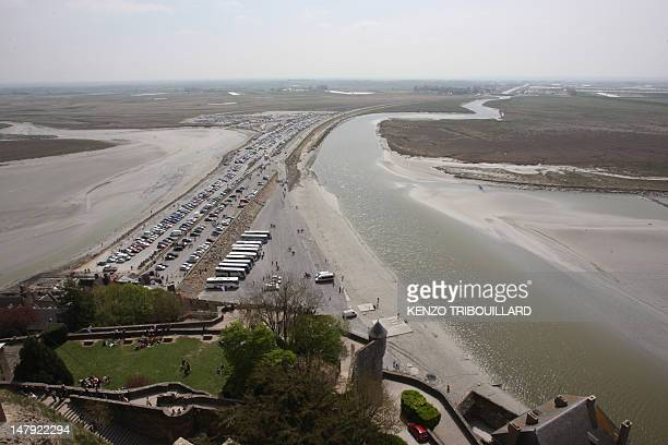 'PETIT A PETIT LE MONTSAINTMICHEL REDEVIENT UN ILE' View taken on April 21 in Le MontSaintMichel northwestern France of the causeway between...