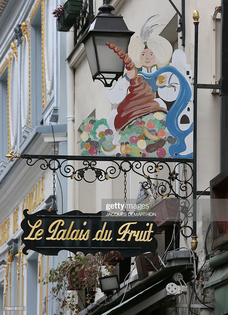 View taken on December 15, 2012 in Paris, shows a commercial sign of a fruit merchant in the 1st district.