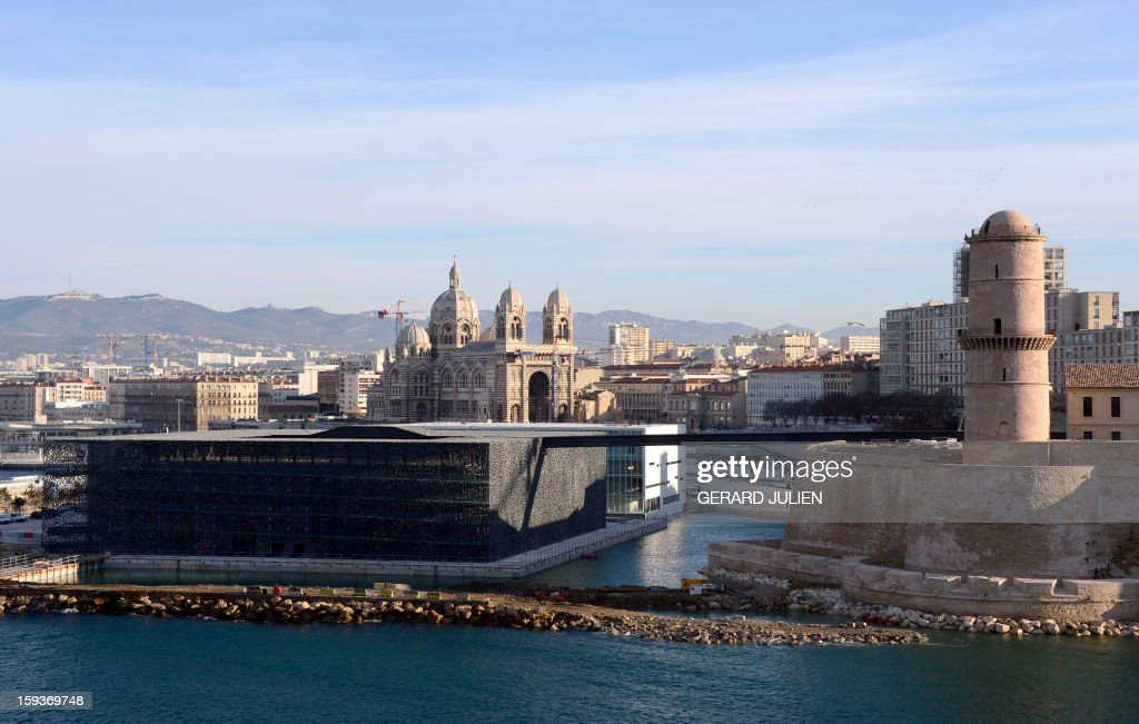 A view taken on January 12, 2013 shows in the foreground the new Museum of Civilizations from Europe and the Mediterranean (MuCEM) (L), designed by Italian architect Rudy Ricciotti, and Fort Saint Jean (R), and in the background the cathedral of Sainte-Marie-Majeure (aka La Major) (L) in Marseille, southern France. Long plagued by a reputation for gang crime and lawlessness, France's port city of Marseille is hoping its year as the 2013 European Capital of Culture will finally give its image a makeover. The gritty Mediterranean city will kick off the festivities on January 12, 2013 with a downtown parade, fireworks and the opening of a slew of exhibitions.