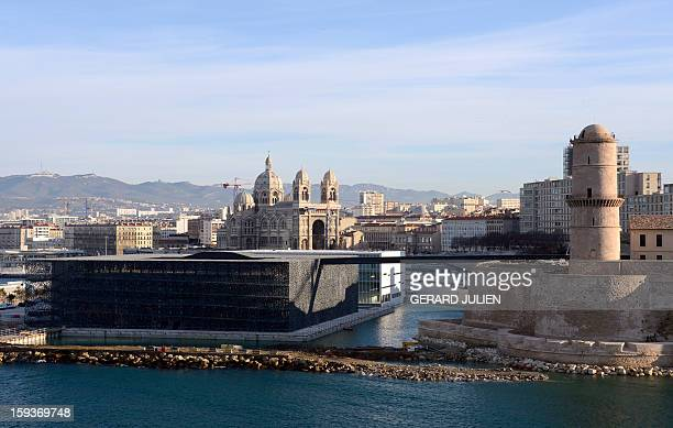 A view taken on January 12 2013 shows in the foreground the new Museum of Civilizations from Europe and the Mediterranean designed by Italian...