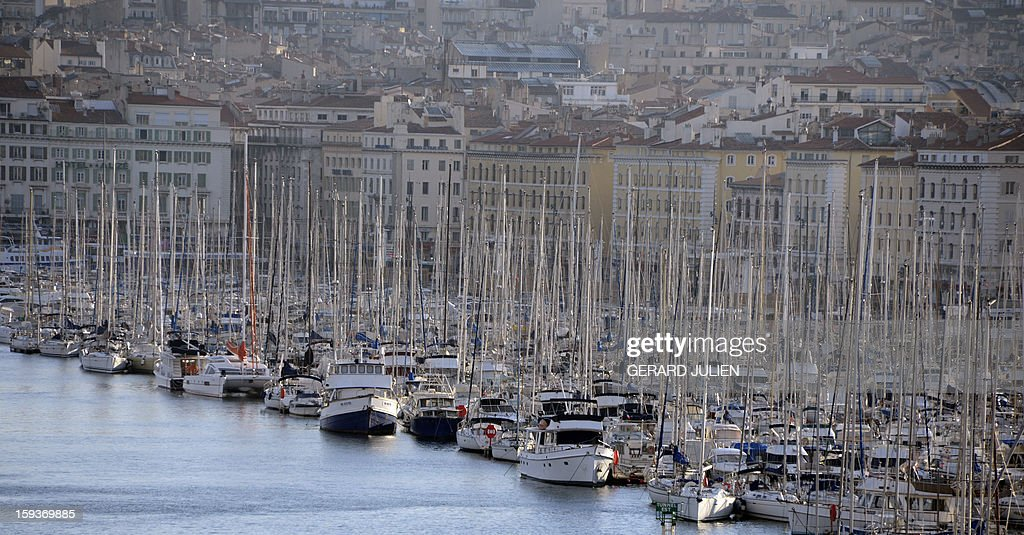 A view taken on January 12, 2013 shows the 'Vieux-Port' (Old Harbour) in Marseille, southern France. Long plagued by a reputation for gang crime and lawlessness, France's port city of Marseille is hoping its year as the 2013 European Capital of Culture will finally give its image a makeover. The gritty Mediterranean city will kick off the festivities on January 12, 2013 with a downtown parade, fireworks and the opening of a slew of exhibitions.