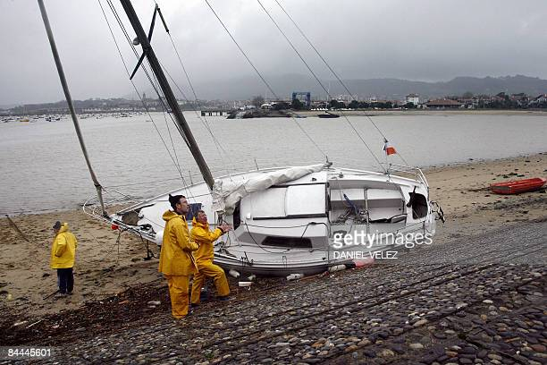 View taken on January 25 2009 shows a beached boat in the French southwestern harbour of Hendaye a day after a storm the worst to hit France since...