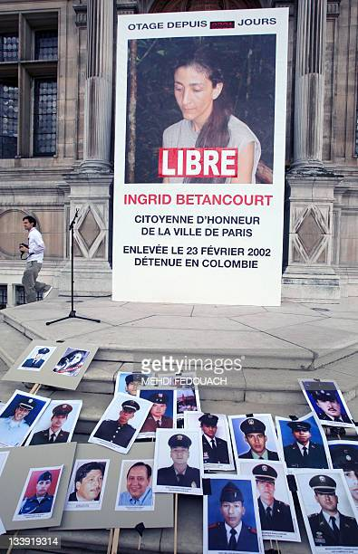 View taken on July 3 2008 in front of the Paris' city hall shows a giant picture of Ingrid Betancourt and pictures of various people held hostages by...