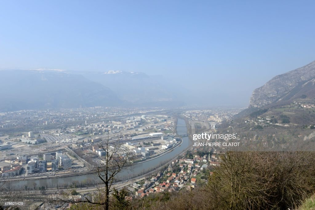 A view taken on March 14, 2014 shows a part of the city of Grenoble and the Gresivaudan valley. More than 30 departments in France are hit by maximum level pollution alerts since the day before, prompting Ecology Minister to say air quality was 'an emergency and a priority for the government.'