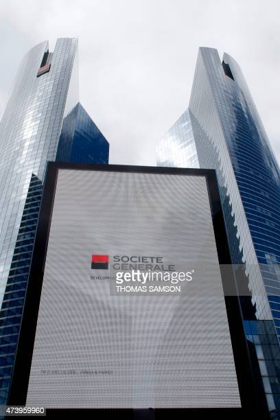 A view taken on May 19 2015 of a sign in front of the French bank Societe Generale headquarters in Paris' financial district of La Defense Bosses at...