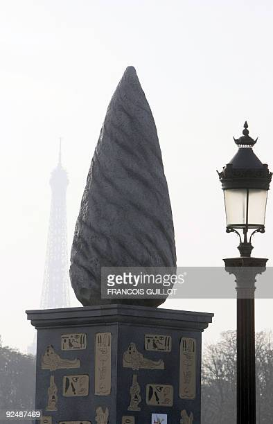 View taken on October 29 2009 shows a menhir and a base with Asterix cartoon character on it displayed Place de la Concorde in Paris as part of the...