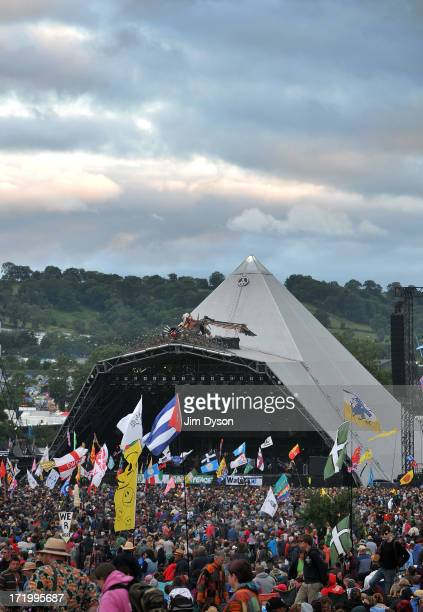 A view the crowd and flags in front of the Pyramid stage during day 4 of the 2013 Glastonbury Festival at Worthy Farm on June 27 2013 in Glastonbury...