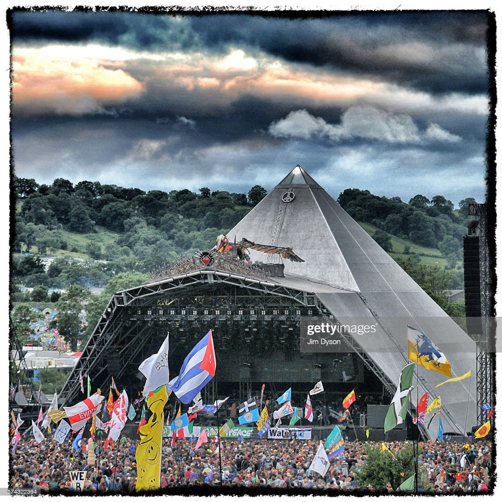 A view the crowd and flags in front of the Pyramid stage during day 4 of the 2013 Glastonbury Festival at Worthy Farm on June 30, 2013 in Glastonbury, England.