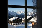 View through a window of a ski resort