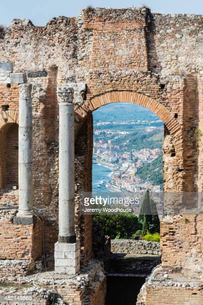 View through arch of Ancient Greek Theatre ruins, Taormina, Sicily, Italy