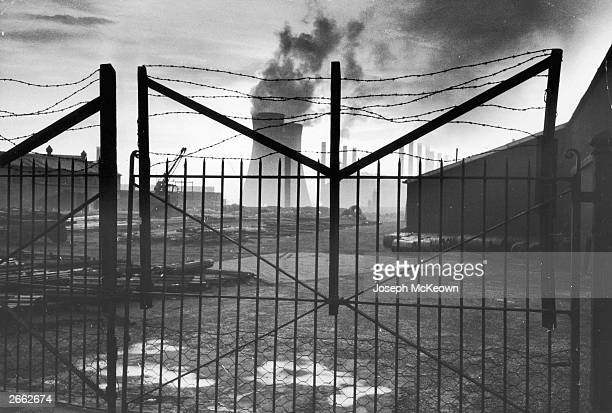 A view through factory gates in Yorkshire Original Publication Picture Post 8067 Importance Of Yorkshire unpub