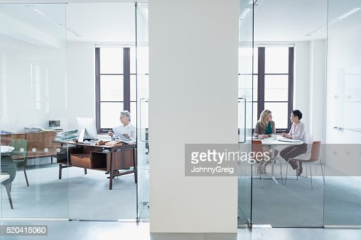 View through glass partition into modern office