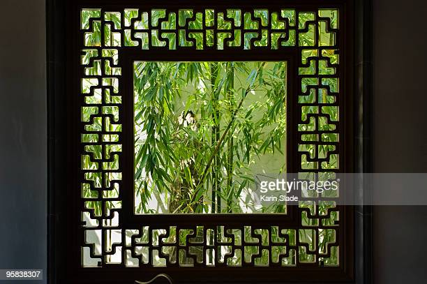 view through screen in a classical Chinese garden,