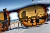 View through sunglasses to Hotel Vela, Barcelona, Spain
