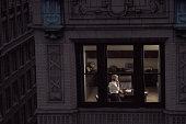 View through window of businessman on phone