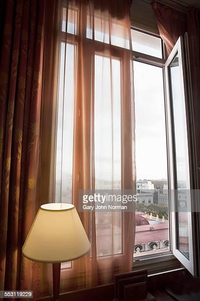 View through window over rooftops in Havana