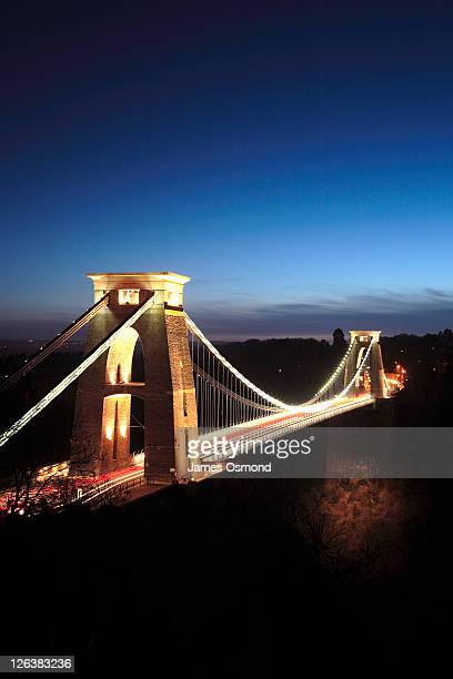 A view to the Clifton Suspension Bridge illuminated at night in Bristol.