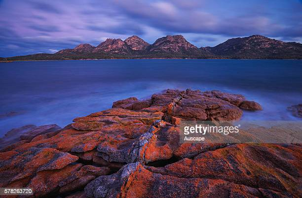 View to the Hazards from Coles Bay at dusk Freycinet National Park Tasmania Australia