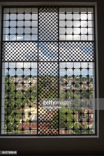 Santa Domingo Dominican Republic November 30 2012 View trough a window with a crux shaped inside above the poor neighbourhood 'Los Alcarrizos' in...