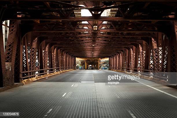 View underneath red metal bridge on Chicago street