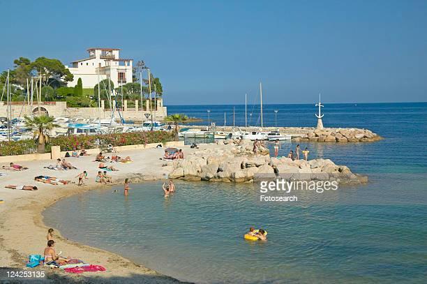 View with beach looking towards Villa Kerylos, Beaulieu-Sur-Mer, France