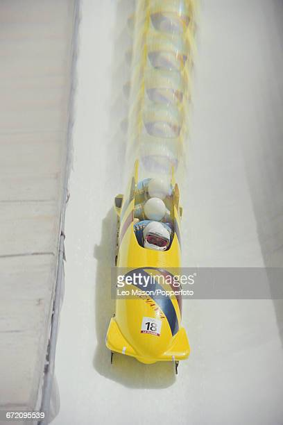 View with 'special effects' filter of the Romania fourman bobsleigh team of Paul Neagu Laszlo Hodos Laurentju Budur and Costel Petrariu in action to...