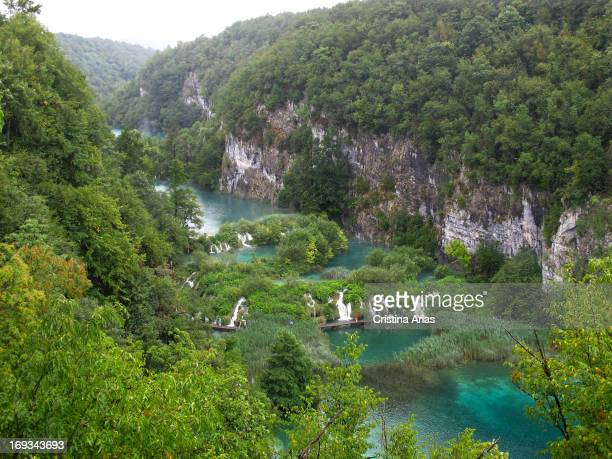 Viewed from above of tourists walking along the wooden walkways to approach the waterfalls in the Plitvice Lakes National Park UNESCO World Heritage...