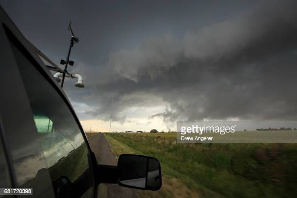 Viewed from the window of a tornado scout vehicle a supercell thunderstorm develops May 10 2017 in Olustee Oklahoma Wednesday was the group's third...