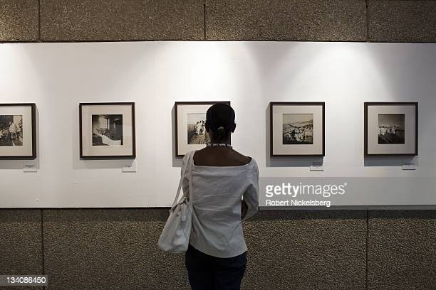 Viewers attend the Mahatma Gandhi photography exhibit at the first Delhi Photo Festival October 22 2011 held at the India Habitat Center New Delhi...