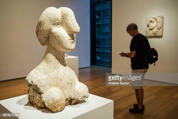 Viewers look at sculptures made by Pablo Picasso at the Museum of Modern Art's 'Picasso Sculpture' exhibit on September 10 2015 in New York City The...