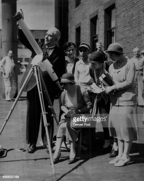 Viewing the Eclipse Prof George Leo Patterson The Denver Post astronomer shown here viewed the eclipse Wednesday thru a telescope on top of The Post...