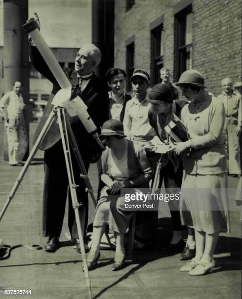 Viewing the Eclipse Prof George Leo Patterson The Denver Post astronomer shown here viewed the eclipse Wednesday day thru a telescope on top of The...
